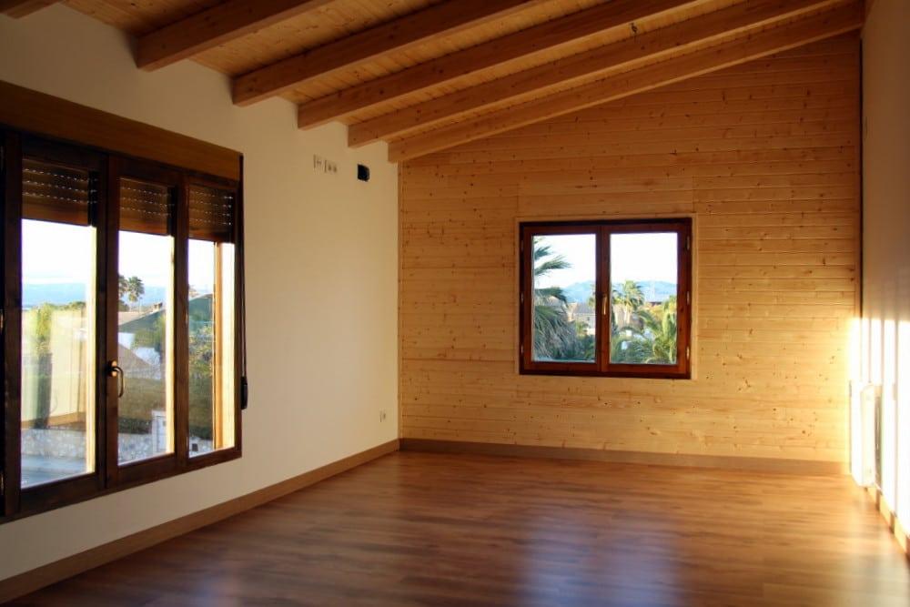Tres ambientes madera machihembrada suelo laminado y pared de obra candel madera y obra - Casas de pladur ...